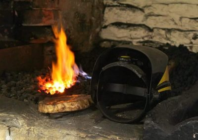 Coal scuttle next to roaring fire