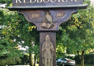 A close up of a town monument with Redbourne 1791-1917 and a knight, duck and possibly a pigeon on it