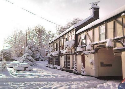 A view of the front of the Red Lion in the snow
